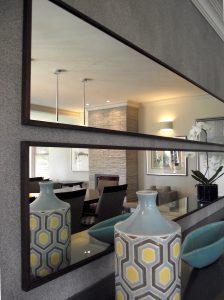 Framed mirrors hung horisontally