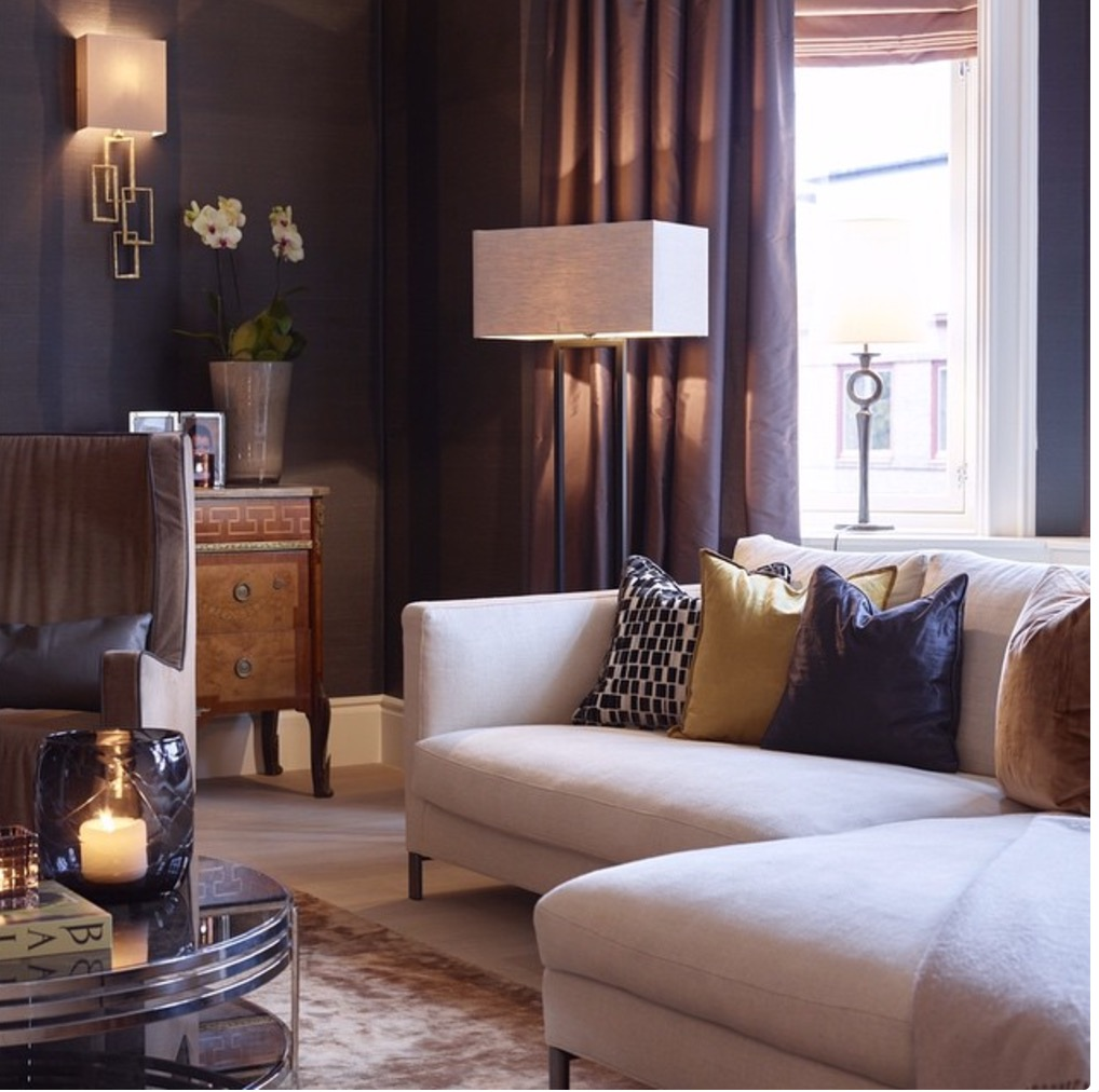Mixed styles Elegant living room with pale sofa against dark walls
