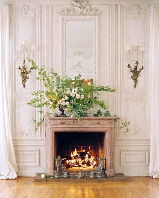 period fireplace with panelled walls and high ceilings